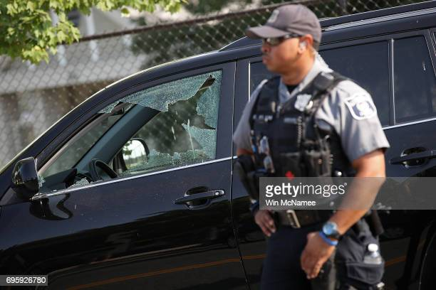 Investigators and emergency personnel gather adjacent to Eugene Simpson Field the site where a gunman opened fire June 14 2017 in Alexandria Virginia...