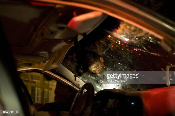 Investigators and Policemen investigate the scene where drug related homicide occured The death industry is booming in the city of Juarez Since...