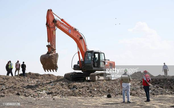 Investigators and recovery workers continue recovery efforts at the crater at the crash site of Ethiopian Airlines Flight 302 on March 13 2019 in...