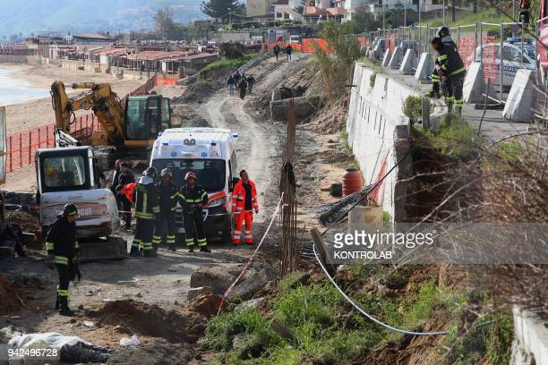 Investigators and rescuers at the site of the accident at work in Crotone Calabria southern Italy where two workers died and one third is seriously...