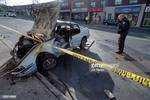 SIU investigators and Toronto police accident officers examine the scene at Eglinton Ave W and Keele St after stolen car the mangled white Grand Am...