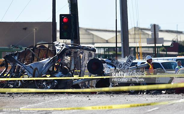 Investigators are seen behind police tape as they walk past the mangled truck that was hit by a Los Angelesbound Metrolink train in Oxnard California...