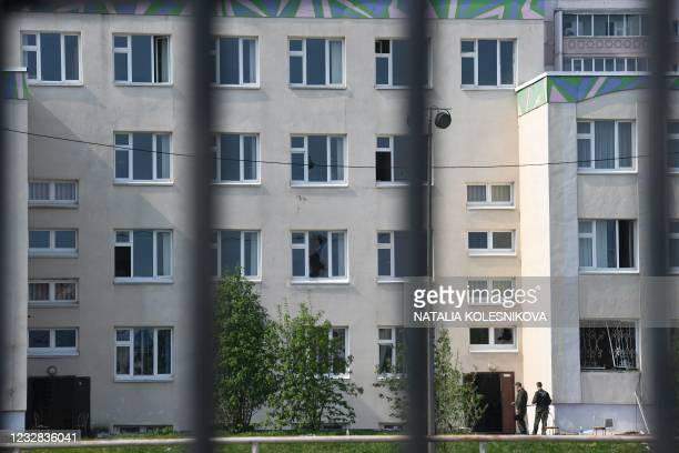 Investigators are seen on the grounds of School No. 175 the morning after the shooting in Kazan on May 12, 2021. - At least nine people, most of them...