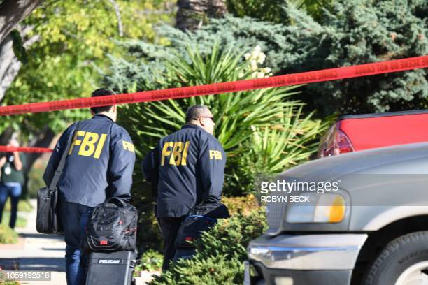 FBI investigators arrive at the home of suspected nightclub shooter Ian David Long on November 8 2018 in Thousand Oaks California The gunman who...