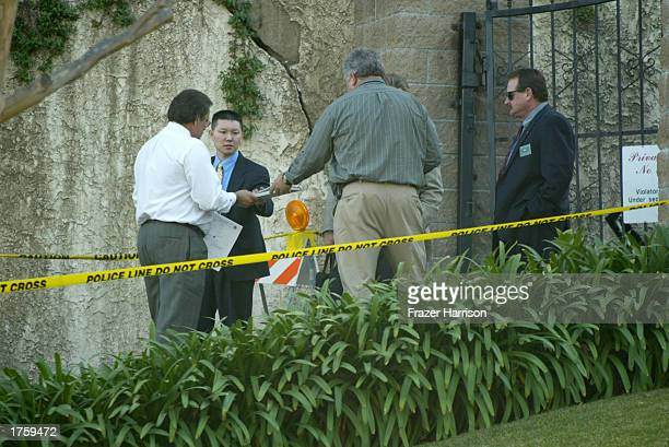 Investigators arrive to 'Pyrenees Castle' record producer Phil Spector's hilltop mansion on February 3 2003 in Alhambra California Spector was...
