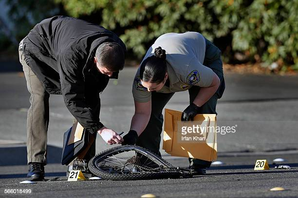 Investigators at the scene where a bicyclist was struck by two vehicles and killed today in Anaheim Police sought one of the motorists who they say...