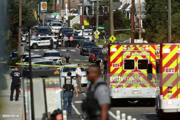 Investigators blanket the area of a morning shooting outside Eugene Simpson Stadium Park June 14 2017 in Alexandria Virginia US House Majority Whip...