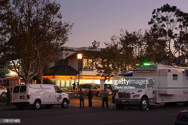 Investigators collect evidence at Salon Meritage hair salon where a man shot nine people killing eight of them on October 12 2011 in Seal Beach...