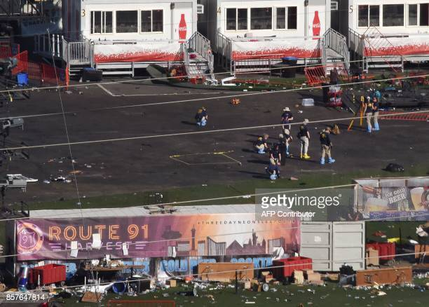 TOPSHOT FBI investigators continue work at Las Vegas Village in Las Vegas Nevada on October 4 the site of the worst mass murder in modern US history...