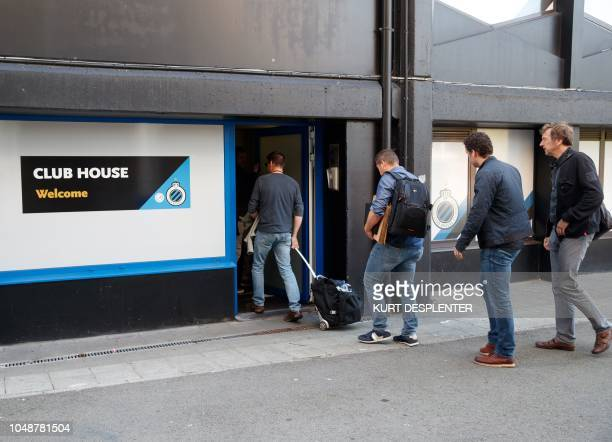 Investigators enter into the premises of Belgium's first divisin football club Club Brugge in Brugge on October 10 where undertook searches as part...