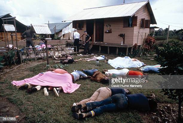 Investigators examine the compound of the People's Temple cult November 18 1978 in Jonestown Guyana after over 900 members of the cult led by...