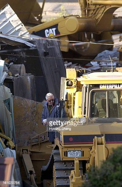 GRANBY CO JUNE 05 2004 Investigators examine the fortified bulldozer driven by Marvin Heemeyer where it came to rest at Gambles of Grand County on...