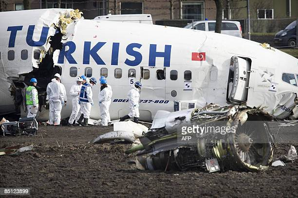Investigators examine the wreck of a Turkish Airlines Boeing 737800 passenger aircraft on February 26 2009 which crashed at Amsterdams' Schiphol...