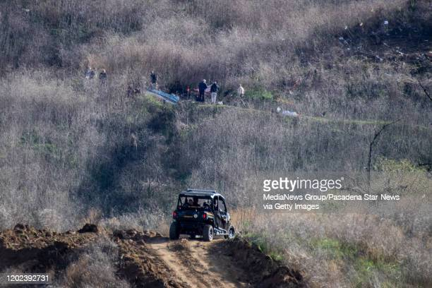 Investigators fan over the Calabasas site on Monday morning January 27 2020 where the helicopter carrying Kobe Bryant and his 13yearold daughter...