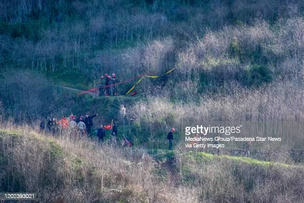 Investigators fan over the Calabasas site on Monday morning, January 27, 2020 where the helicopter carrying Kobe Bryant and his 13-year-old daughter...