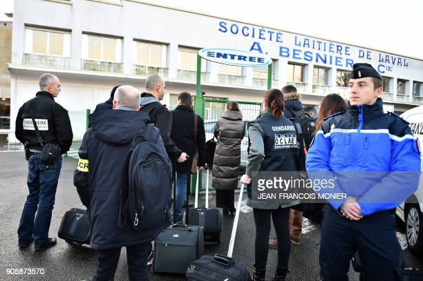 Investigators from the Angers research section arrive to conduct a search at the Lacatlis group headquarters on January 17 in Laval northwestern...