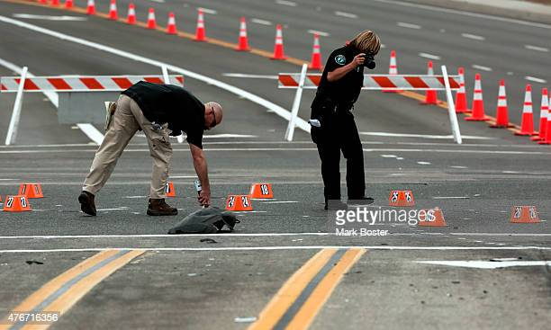 Investigators from the Irvine Police Department look for evidence at the the scene of a fatal hitandrun accident at the intersection of Muirlands...