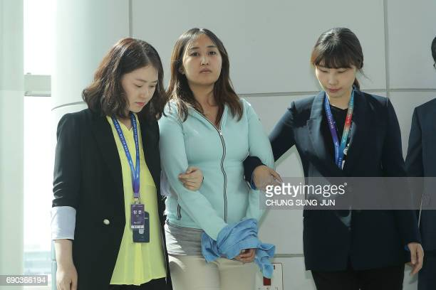 Investigators from the South Korean prosecution escort Chung YooRa the daughter of Choi Soonsil the close confidante of impeached expresident Park...