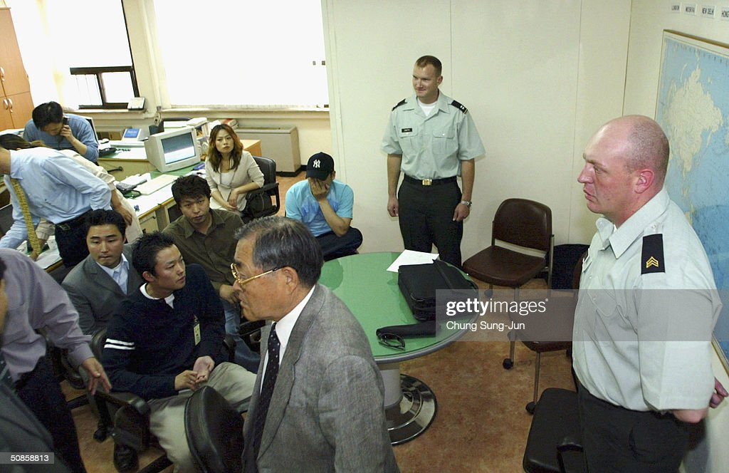 Investigator's from the United States Forces Korea (USFK) and South Korean investigator speak at the police station on May 20, 2004 in Seoul South, Korea. Five U.S. soldiers and one Korean soldier were arrested on May 15, following an attack on a 27-year-old civilian who had tried to stop the soldiers from making a disturbance in the area, the unidentified victim underwent surgery on his neck at a nearby hospital and remains in a non-critical condition.