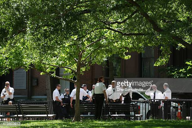 Investigators from the US Park Police the US Secret Service the DC Metropolitan Police Department and other law enforcement agencies collect evidence...