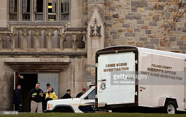 Investigators gather in front of Norris Hall following a mass killing at the southwestern university Virginia Tech April 16 2007 in Blacksburg...