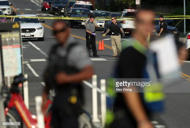 Investigators gather near the scene of an opened fire June 14 2017 in Alexandria Virginia Multiple injuries were reported from the instance