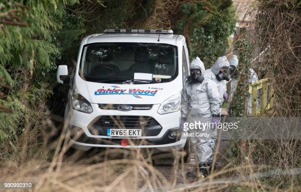 Investigators in protective clothing remove a van from an address in Winterslow near Salisbury as police and members of the armed forces continue to...