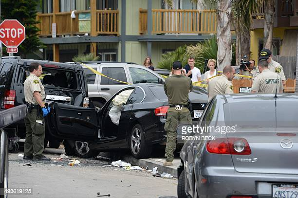 Investigators inspect a suspected gunman's car on May 24 after a driveby shooting in Isla Vista California a beach community next to the University...