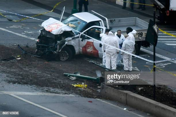 TOPSHOT Investigators inspect a truck following a shooting incident in New York on October 31 2017 Several people were killed and numerous others...
