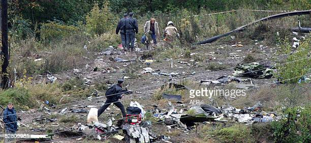 Investigators inspect the scene of AeroflotNord Boeing 737 crash in Perm on September 14 2008 Twentyone foreign nationals from countries including...