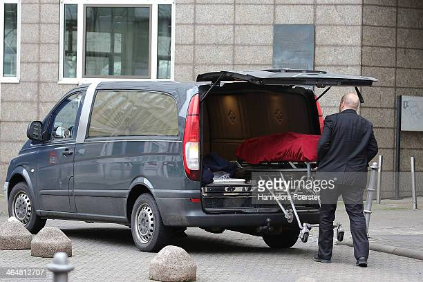 Investigators load the body of a man killed outside the Landgericht Frankfurt courthouse into a hearse on January 24 2014 in Frankfurt Germany...