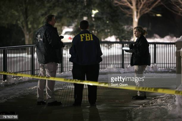 Investigators look for evidence outside Cole Hall following a shooting on the Northern Illinois University campus February 14 2008 in De Kalb...