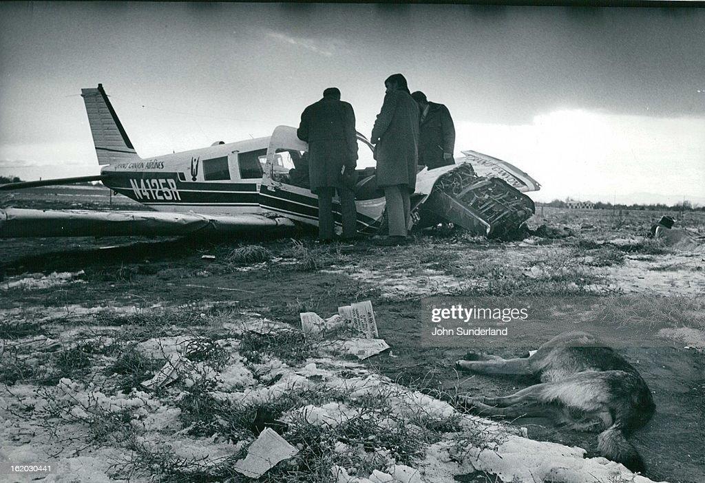 NOV 28 1976, NOV 30 1976; Investigators Look over the Wreckage of Single-Engine Plane that crashed M : News Photo