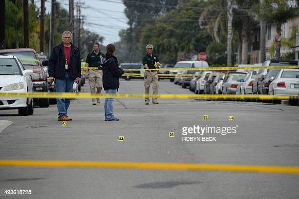 Investigators mark evidence on May 24 after a drive-by shooting in Isla Vista, California, a beach community next to the University of California...