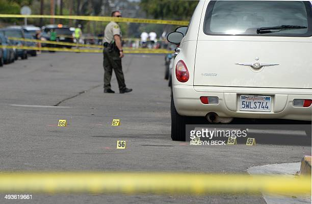 Investigators mark evidence on May 24 after a driveby shooting in Isla Vista California a beach community next to the University of California Santa...