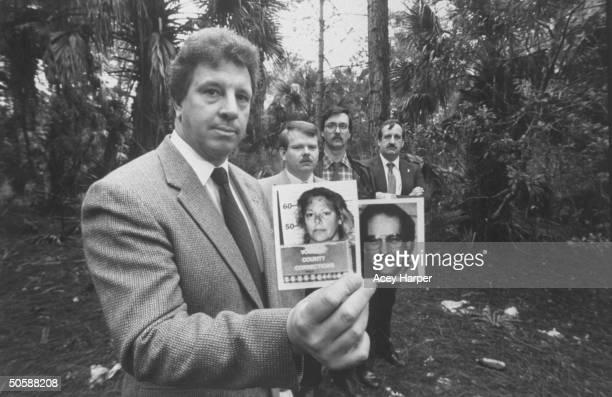 Investigators of lesbian serial murderer Aileen Wuormos Richard Vogel Bob Kelley Larry Horzepa Jake Erhart holding mug shots of Aileen Wuormos 1st...