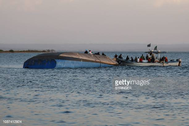 Investigators on boat work on the capsized ferry MV Nyerere which killed 131 people in Lake Victoria Tanzania on September 21 2018 Tanzanian...