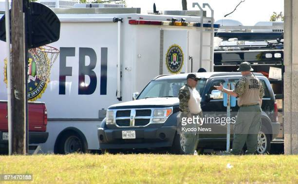 Investigators on Nov 7 inspect the church in Sutherland Springs Texas where a gunman killed 26 people Nov 5 Police say the suspect identified as...