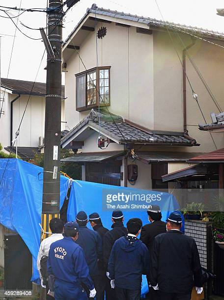 Investigators search the home of Chisako Kakehi and her deceased husband Isao on November 20 2014 in Muko Kyoto Japan Police arrested a fourtime...