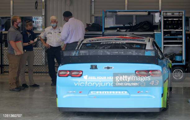 Investigators speak with personnel in the garage area prior to the NASCAR Cup Series GEICO 500 at Talladega Superspeedway on June 22 2020 in...
