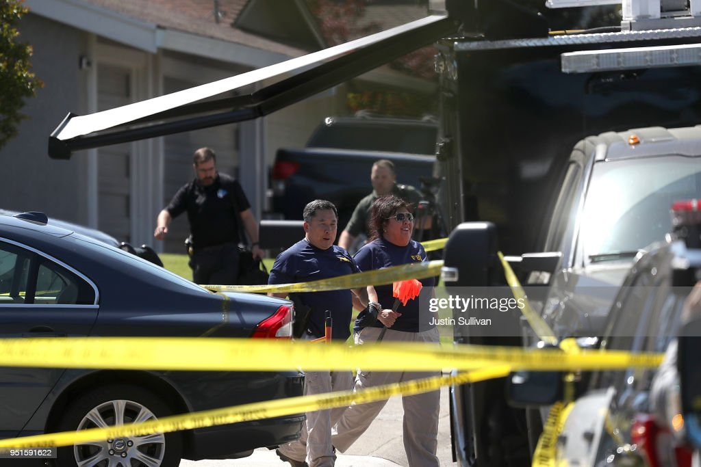 FBI investigators stand in front of the home of accused rapist and killer Joseph James DeAngelo on April 24, 2018 in Citrus Heights, California. Sacramento District Attorney Anne Marie Schubert was joined by law enforcement officials from across California to announce the arrest of 72 year-old Joseph James DeAngelo who is believed to be the the East Area Rapist, also known as the Golden State Killer, who killed at least 12, raped over 45 people and burglarized hundreds of homes throughout California in the 1970s and 1980s.