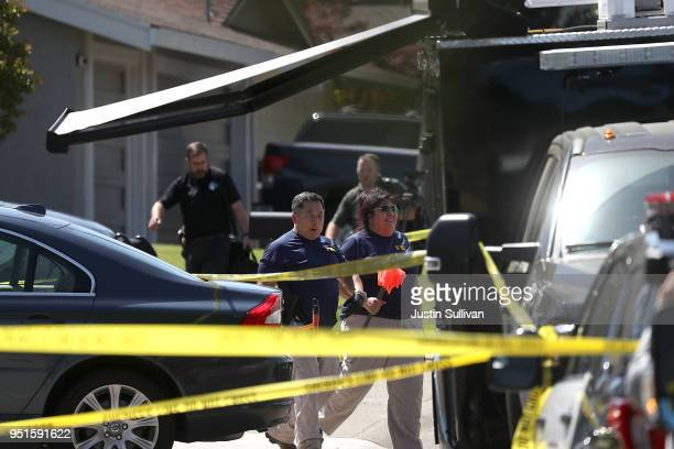 FBI investigators stand in front of the home of accused rapist and killer Joseph James DeAngelo on April 24 2018 in Citrus Heights California...