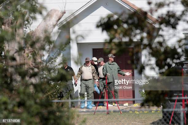 Investigators walk out of the First Baptist Church of Sutherland Springs on November 7 2017 in Sutherland Springs Texas On November 5 a gunman Devin...