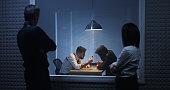Investigators watching an interrogation