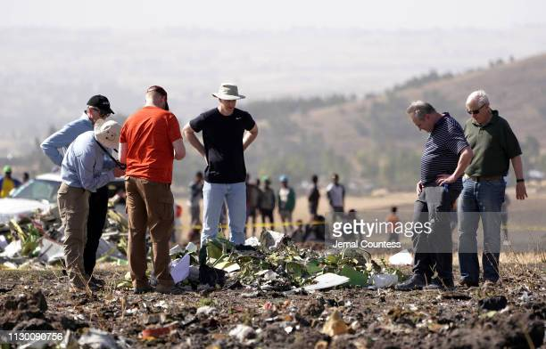 Investigators with the US National Transportation and Safety Board look over debris from the crash site of Ethiopian Airlines Flight ET 302 on March...