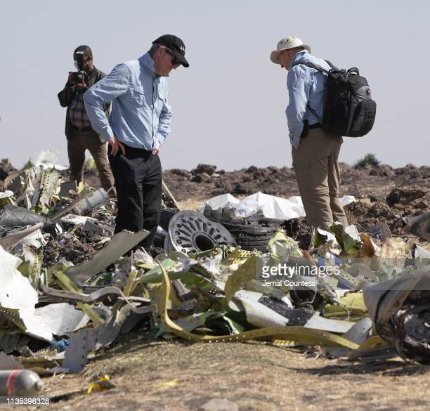 Investigators with the US National Transportation and Safety Board look over debris at the crash site of Ethiopian Airlines Flight ET 302 on March 12...