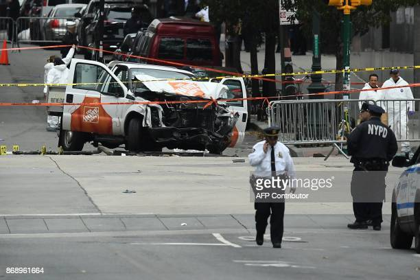 Investigators work around the wreckage of a Home Depot pickup truck a day after it was used in a terror attack in New York on November 1 2017 The...