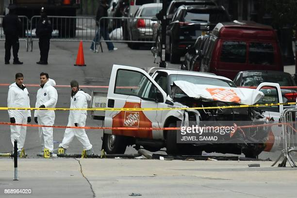 TOPSHOT Investigators work around the wreckage of a Home Depot pickup truck a day after it was used in a terror attack in New York on November 1 2017...