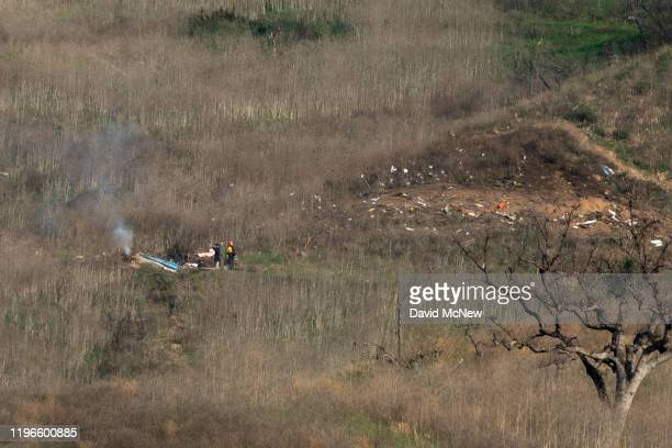 Investigators work at the scene of a helicopter crash that killed former NBA star Kobe Bryant on January 26 2020 in Calabasas California Nine people...