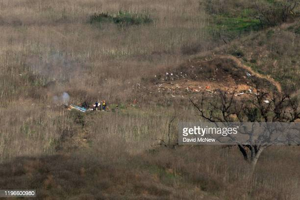 Investigators work at the scene of a helicopter crash that killed former NBA star Kobe Bryant on January 26, 2020 in Calabasas, California. Nine...